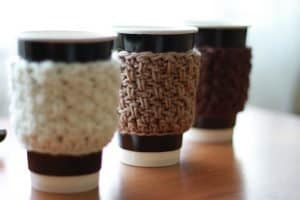 3 different coloured crochet cup cozy
